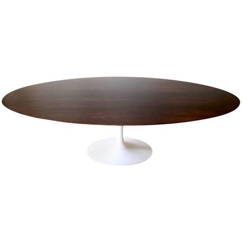 saarinen oval dining table 96 96 quot saarinen walnut dining table at 1stdibs