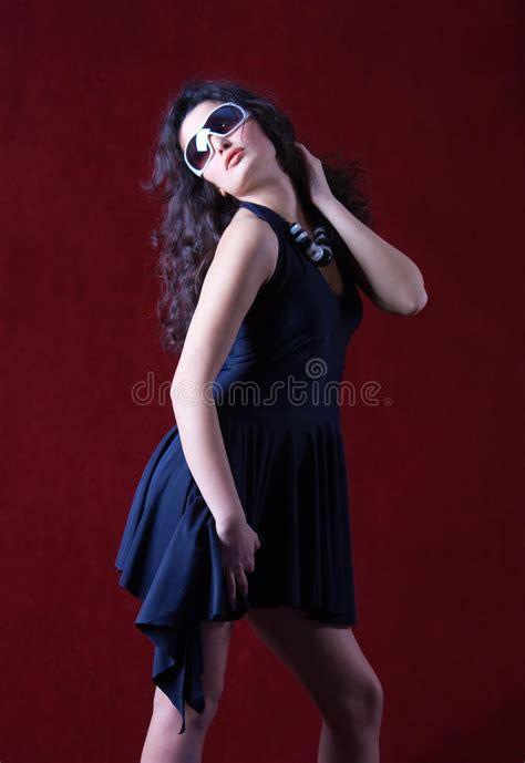 Dress Model Blue Fashion Impor fashion model in a blue dress wearing sunglasses stock photos image 16606073