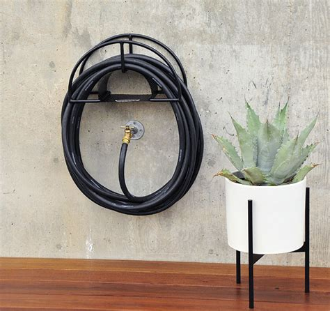 garden hose wall mount 10 easy pieces hose hangers from high to low gardenista