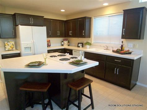 updating oak kitchen cabinets before and after home staging tip dated oak cabinets update them with paint
