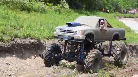 Jacked Up Toyota Tacoma Jacked Up Toyota Tackling The Tank Trap