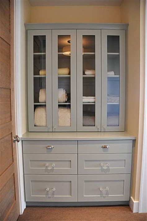 bathroom linen cabinet with glass doors build in shelves with glass doors and drawers rather than