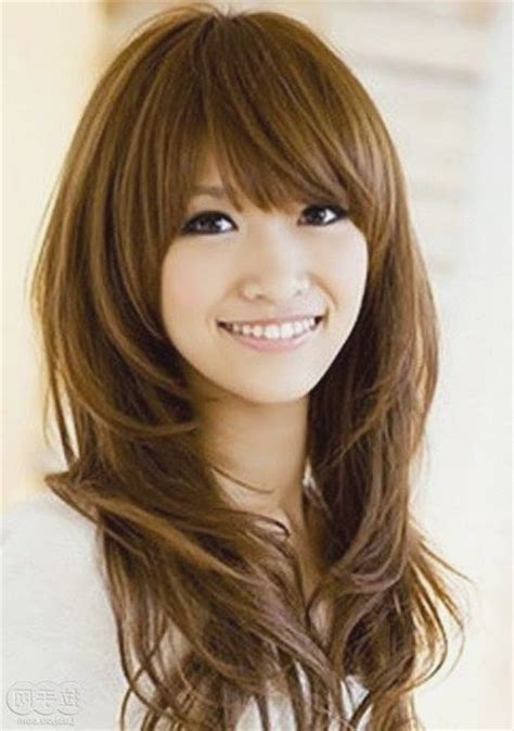oval head long hair cute long hairstyles with bangs and layers for oval faces