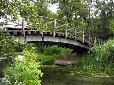 small wooden bridge large wooden bridge over the river landscape stock