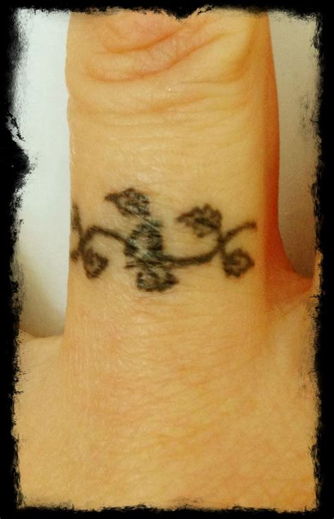 vine tattoo finger wedding ring tattoo vine tattoos pinterest rings