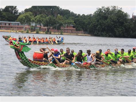 dragon boats take over the lake roodepoort record - Dragon Boat Racing Florida Lake