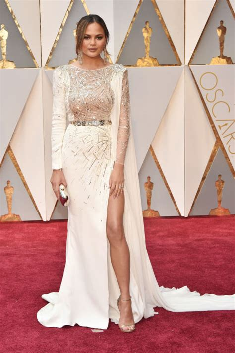 chrissy teigen in zuhair murad red gold at the oscars hipboulevard