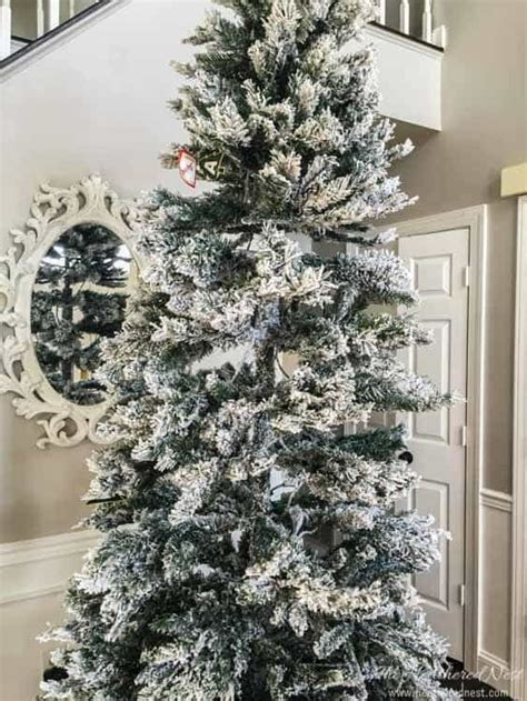 how to fix artificial christmas tree branches quot spruce quot up your tree with real pine branches the heathered nest