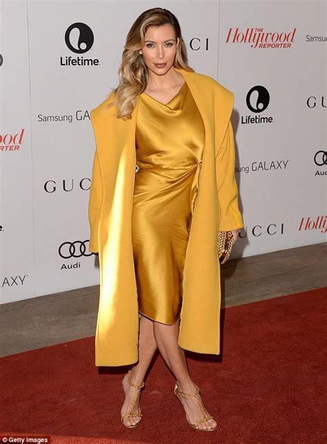 kim kardashian mustard dress kim kardashian goes overboard in a yellow coat and