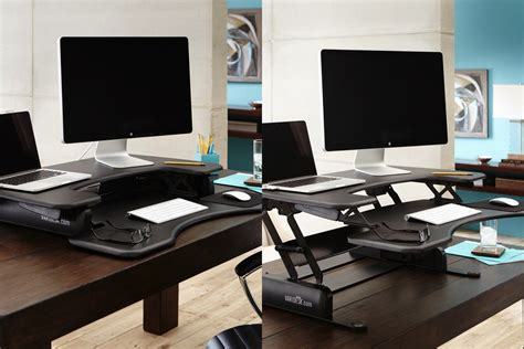 convert your desk to a stand up desk standing desk converter relieve back pain lorell sit to