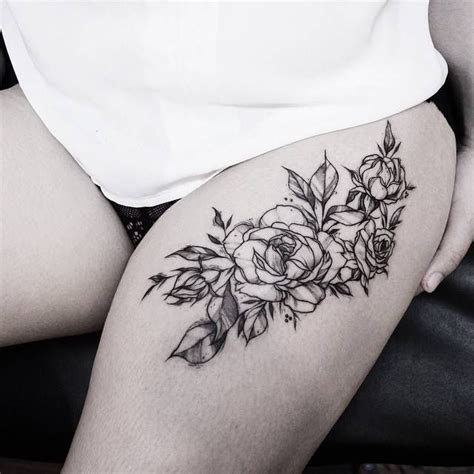 bunch of roses tattoo a thighs and piercings