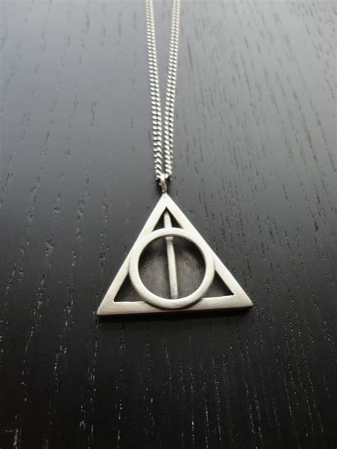 pin deathly hallows necklace topic ban clubmaster