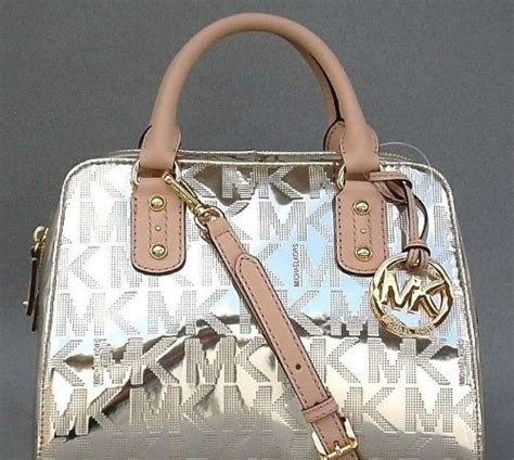 Mk Small Pale Gold michael kors monogram mk embossed patent small satchel