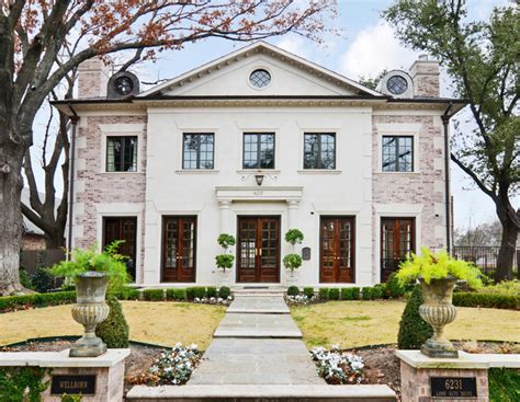 french chateau style home in stucco cast stone brick limestone facade traditional exterior dallas
