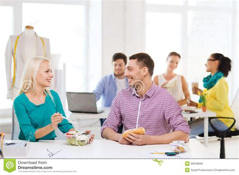 Fashion Designer Education And by Smiling Fashion Designers Lunch At Office Stock Photo Image 50049849