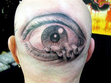 eyeball tattoo on back of head finger in eye bing images