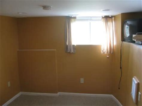 orange paint color in the basement bedroom