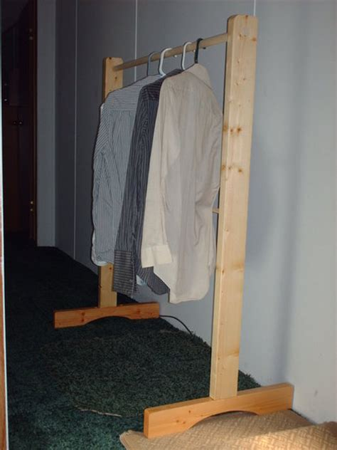 Build A Clothes Rack by How To Build A Wooden Garment Rack Plans Diy Free