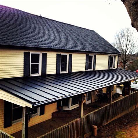 black metal roof gaf charcoal shingles with black standing seam metal roof
