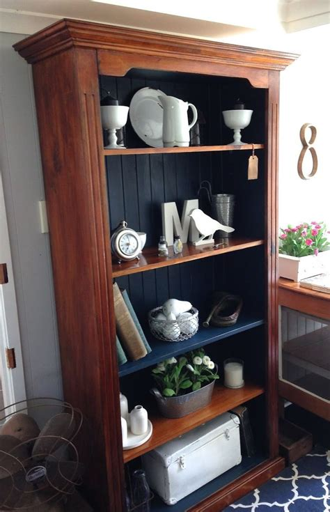 we how this timber bookcase was left bare on the