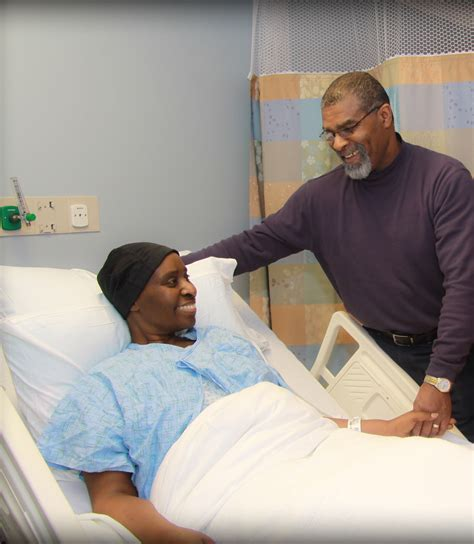 person in hospital bed role of a support person visiting information patients