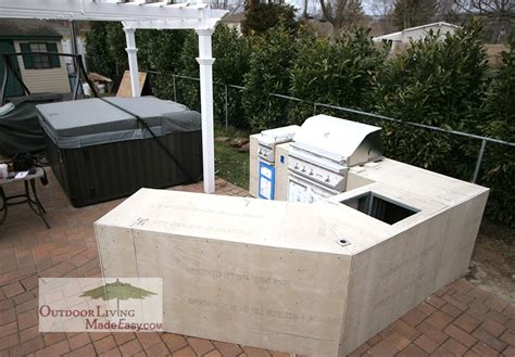 custom outdoor kitchens 2013 lazy l kitchen with counter height seating and umbrella holder