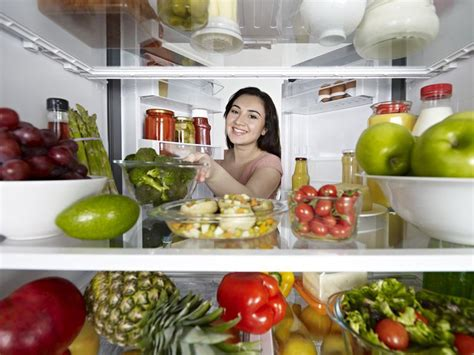 Shelf Of Refrigerated Foods by The Shelf Of Leftovers And Refrigerated Foods