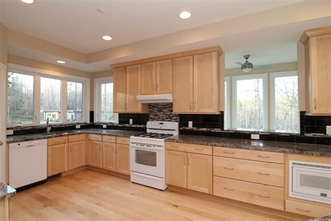 maple cabinets with white countertops black and white kitchen with maple cabinets floor white