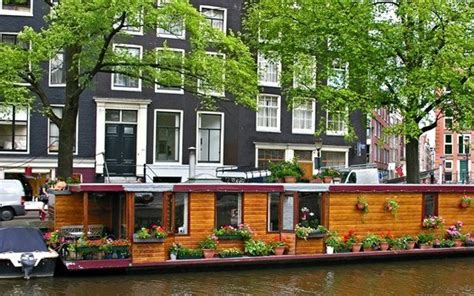 boat houses in amsterdam houseboats in the amsterdam canals holland com