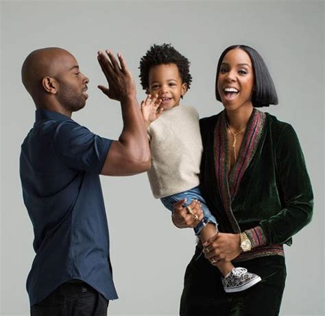Kelly Rowland and Tim Weatherspoon celebrate their 4th