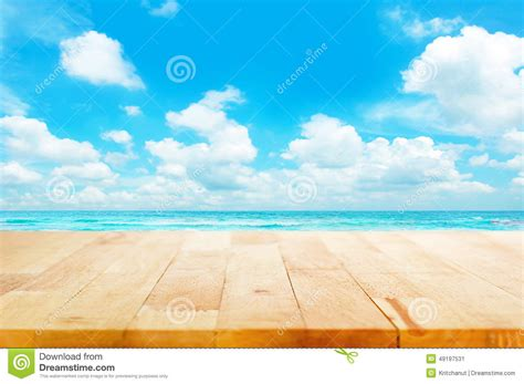 Designers Kitchen by Wood Table Top On Blue Sea Amp Sky Background Stock Photo