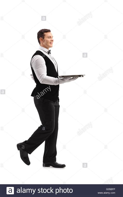 length profile of a waiter walking with an empty tray stock photo royalty free