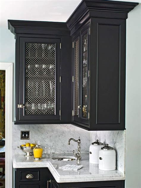 bold black cabinets fitted  wire mesh door fronts