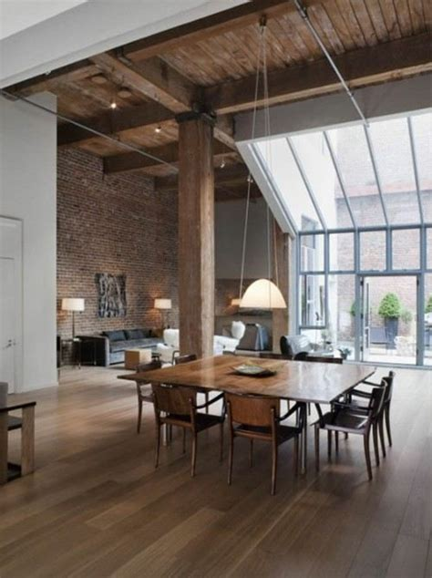exposed brick and timber interiors flooded by light exposed brick walls and wood ceilings interiors