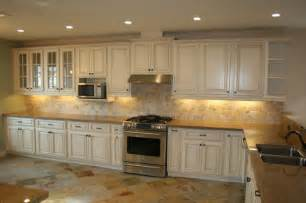 White Antiqued Kitchen Cabinets Getting That Timeless Kitchen Aura With White Cabinets