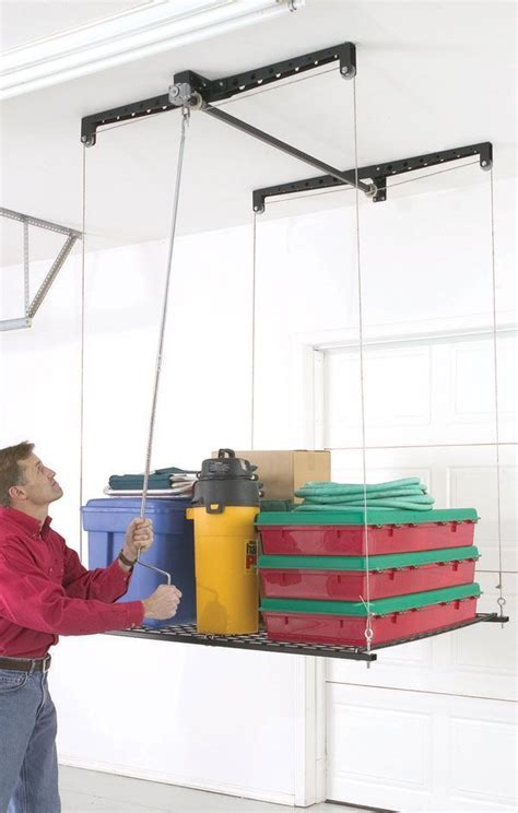 ceiling storage lift 1000 ideas about garage ceiling storage on ceiling storage overhead storage and