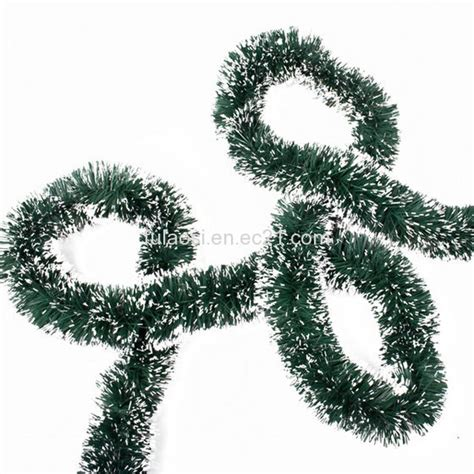 traditional green tinsel garland for christmas tree id