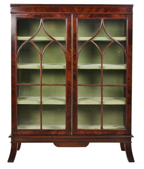 a floor standing mahogany bookcase