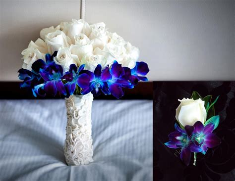 ivory and blue orchid reception wedding flowers