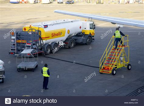 shell aircraft fuel tanker driver on mobile steps examining stock photo royalty free image