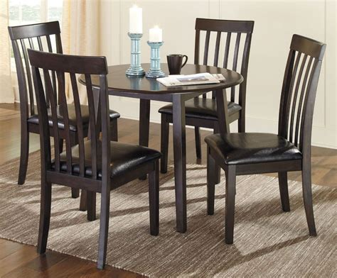round dining room sets with leaf hammis round drop leaf dining room set from ashley d310