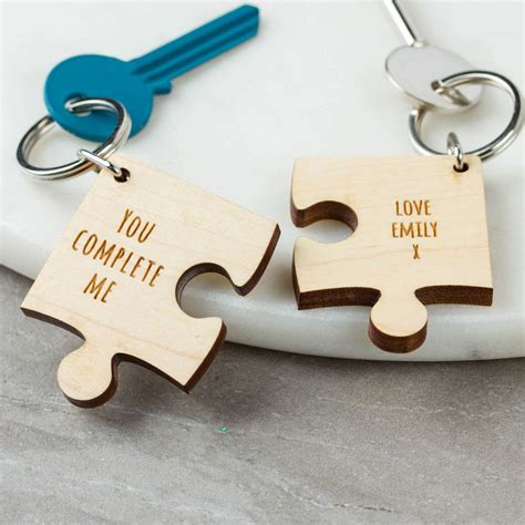 we love jigsaw puzzles the missing piece puzzle company personalised wooden gift missing piece jigsaw keyring by