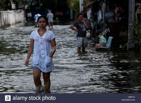 bangkok residents wade through flood water from the