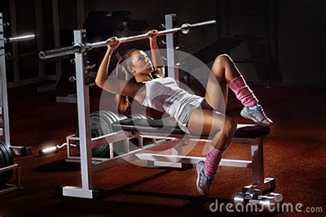 girl bench press girl in gym bar bench press stock images image 28329124
