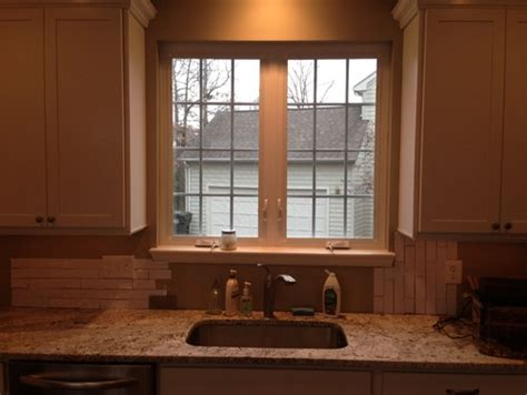Subway Tile Kitchen Backsplashes need help with where to end tile backsplash around window