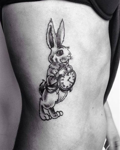collection of 25 white rabbit tattoos on arm