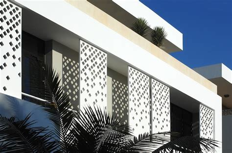islamic pattern building 4 houses find shade from saudi sun with sliding islamic