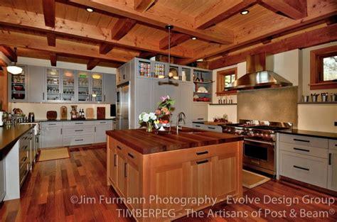 mullet cabinet rebuilt timber frame barn home kitchen mismatched cabinets timberpeg timber frame post and beam