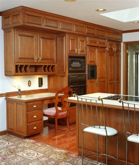 traditional style kitchen with cherry wood cabinets
