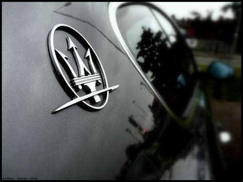 maserati car symbol maserati logo wallpaper world of cars